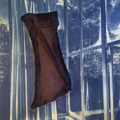 Trace d'un tissu flottant sous la véranda